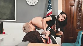 Lesbian teacher Ryan Keely is licking yummy teen slit in 69 style pose